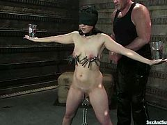 Playful brunette gets down on that dagger in this BDSM