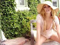See the classy blonde belle Heather Vandeven flaunting her sexy ass and lovely tits while playing with her sexy pussy in the garden.
