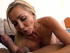 Smokin hot blonde princess Lisa DeMarco is smiling and gagging on a hard dick on the sofa. It is black and very fat. It is what her tight pink meat hole needs the most.