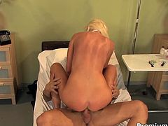 She looks extremely hot topless and in short white skirt. She massages his cock with her massive impressive boobs and brigs him a galore of pleasure.