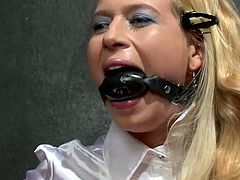 These voracious bitches love BDSM elements so they play kinky games in Tainster porn clip. Blonde one is hogtied with with a gag in her mouth. Her mistress goes harsh on her.
