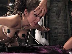 Horny chick gets tied up and fingered. Later on she also gets her tits hit with electricity and toyed with a vibrator.