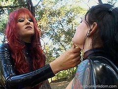Redhead and brunette are both in some leather stuff. Kinky lesbos with heavy makeup look rather frightening. Voracious chicks are in the woods. Dominant slim and pale nympho stretches legs wide to get her wet pussy tickled, stimulated and licked for dozen of pleasure.