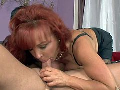 Sexy Vanessa is a good looking big breasted mature redhead. She turns on her step-son with her juggs and takes his rock stiff cock in her experienced mouth. Watch stacked milf give headjob.