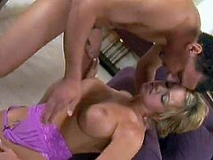 Tanned jaw dropping blonde bimbo with big fake hooters and long sexy nails gets fucked hard in the ass by her randy neighbor all over living room in close up