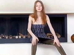 Gloria is a pale skinned skinny teen girl that poses on the floor by the fireplace in short dress and pantyhose. She makes no secret of her nice natural titties. Watch tender Gloria pose topless.