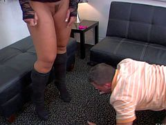 Sexy Savannah Fox with nice juicy ass and long legs gets femdom action started. She smothers a guy with her butt cheeks. Then he licks her boots and bare feet obediently. She loves foot fetish fun!