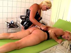 Pitiless domina in latex lingerie slaps hard a cuddly ass of submissive chic making her moan with pain in sizzling hot DDF Network sex video.