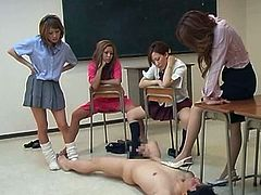 Horny schoolgirls are enjoying their teacher during impressive group sex scene at school