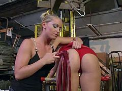 Horny and dominant blonde Kathia Nobili enjoys in punishing her lesbian submissive friend in red lingerie with a matching red whip and has fun in the storage place