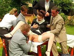 Strict looking mature office manager helps her boss during business negotiations, which end up with steamy gangbang sex orgy where she kneels down to oral fuck bunch of hard cocks simultaneously.