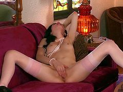 Stunning brunette Aiden Ashley in nylon stockings and black shoes exposes her tiny nipples and strokes her neat pussy with her long slim legs apart on the couch. Watch glamorous Aiden Ashley play with herself.