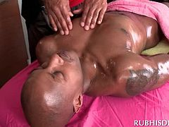 Black gay hottie giving body massage to dude
