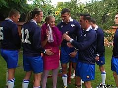 Sex greedy whore visits a soccer team during their training outdoors. She drink with them hard before she lies on the table with legs spread aside to welcome a tongue fuck while mouth fucking another sturdy penis in sizzling hot gangbang sex video by Tainster.