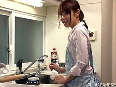 Sexy Japanese chick Maika is having fun with a delivery boy in the kitchen. She has no money to pay for the pizza so she suggests the dude to give him a blowjob.