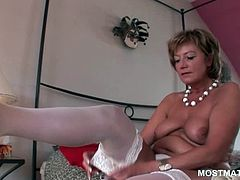 Smoking hot mature blonde in sexy lingerie vibrating her pussy