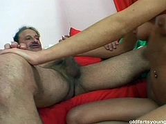 Svelte brunette hussy takes part in insane threesome sex orgy with old couple. She rides ruined cock of rapacious daddy in reverse cowgirl style while being watched by his wifey, who rubs her cunt with hand.
