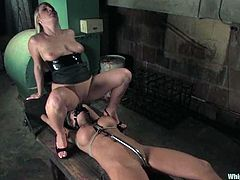 Sexy blonde mistress Harmony is having fun with beautiful chick Nika Noire in a basement. Harmony ties and beats Nika and then slams her vag with a strapon.