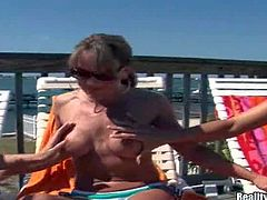 Brianna Ray and two of her wild and lusty girls enjoy in making a hot and arousing lesbian threesome in the sun on the chairs by the swimming pool
