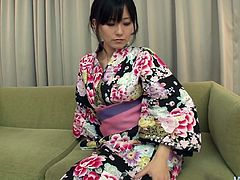 Manami Komukai is a dainty pale skin Japanese beauty. She takes off her silk robe and gets her delicious hairy cunt fondled with two massive vibrators.