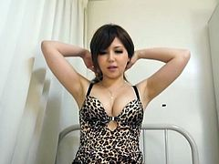 This cute Japanese babe teases her man's cock by running her tongue overtop his underwear covered crotch. She finally pulls out his dick and licks the tips with her tongue. She runs her tongue over all of his penis, even under the head.
