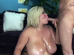 Kacey is twice the size of Scott and for him that means twice the pleasure. The skinny guy oils her big boobs and belly and then has some fun with this massive whore. He watches her how she rubs her pussy slowly while sucking his dick and that was just for warming things up. See how the blonde get's used by him