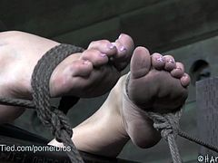 Watch this bdsm video of blonde slut named as Bailey Blue,She is really a Flexible blonde as you can see in the video, that she is tied with her heels over her head.Cyd Black teases her pussy with a vibrator before letting her cum hard.
