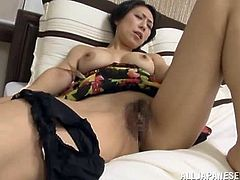 Before she goes for her mid afternoon nap this lovely mama likes to use her vibrator on her vag to make it wet.