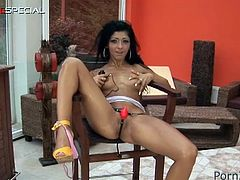 See the hot brunette temptress Claudia flaunting her lovely tits with  small vibrator attached to her clit before sucking a huge vibrator.