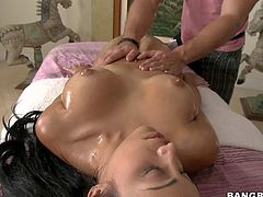 Abella Anderson is a perfect bodied brunette who is nmaked, wet and so sexy on massage table. Beauty gets her sexy ass and big boobies touched by masseur before he takes care of her trimmed innie pussy.