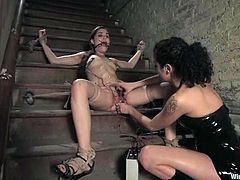 Sasha sits on the steps being tied up and gagged. She gets her pussy clothespinned and toyed hard by her mistress.
