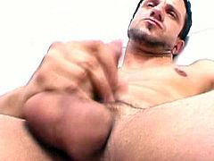 Nando undresses down to his boxer short,start stroking the monster cock,Watch this hot latino twink with massive and tight ass.While jerking his cock,he fingers his tight anal hole.