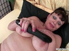 Stockinged bitchy mature sucking and teasing pussy with a huge dildo