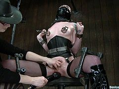 Bondage devices all over the place that restraints this bitch and a sadist that toys with her in this perverted scene right here, check it out!