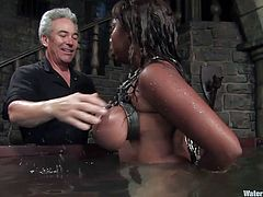 A big titty ebony fucking whore gets bound and toyed with in this perverted BDSM scene with water involved, check it out!