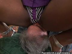 Ebony slut with big tits likes face sitting and feeling her slave licking her well