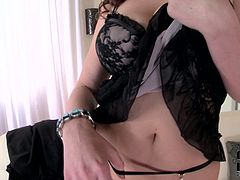 Seductive mommy is taking off her tempting lingerie