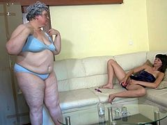 It not often to find a young babe and an old granny side by side. While this chubby granny was undressing, the girl with small and nice boobs is playing dildo. After some times that old women join her and as well as starts satisfying her pussy with a dildo by spreading her legs wide. Watch!