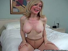Blonde mature with big tits enjoys masturbating her wet vag through those sexy pantyhose