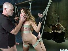 Lovely girl gets bounded and gagged by a bald guy. After that she gives him a blowjob and gets toyed with a vibrator. Then she also gets fucked in her hot vagina.
