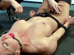 Ariel is an obedient sex slave, she stays laid on the floor, tied up and ball gagged, as the blonde slut Lee attaches electrodes all over her sexy body. After she's done, Lee shocks the girl and gives her to taste sweet bald pussy. Curious what else she wants to do with her?