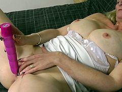 Blonde mature Suzie is alone and she feels horny. The bitch has a bald, sweet cunt and she rubs it with her fingers. After she warmed up her pussy she needs more so Suzie takes out her big dildo and gives it a suck before filling her cunt with it. That's right she now has something to fuck her cunt and works it
