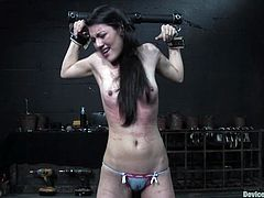 Get a load of this bondage video where a sexy brunette's put through lots of pain as well as being masturbated with no chance of cumming.