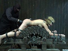 A blonde bitch gets restrained with bondage devices and then this sadist fucker abuses her and she loves every fucking second of it.