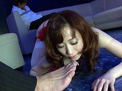 Japanese girl in fishnets and latex corset licks guy's fingers and toes. After that she sucks dicks and gets fucked hard.