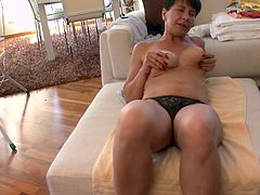 While doing her housework Lucienna suddenly felt horny. She was ironing but soon thew bitch forget about that and started to rub her boobs and get naked. Now she's laid on her couch and plays with her breasts. Are we going to see her playing with her pussy too?