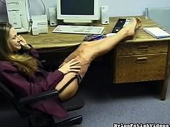 Hot office lady enjoys posing her feet and get horny during solo scene