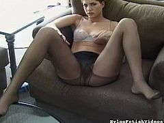 She likes posing in her sexy lingerie while rubbing her feet and gently touching them
