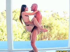 She is skinny teen chick with tight pussy hole. Mature bald dude lifts her up in his hands fucking her bad in a standing position. Later, petite chick takes juicy dick in her mouth sucking it deepthroat.