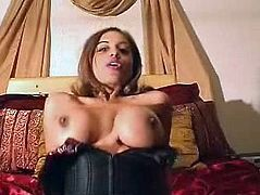 Slutty Indian whore is wearing tight corset sitting on a bed in front of the cam. She puts small amount of cream on her nipples. Then she smears it all over her tits.